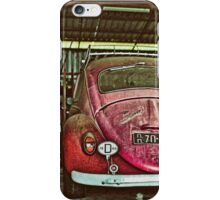 Vintage pink Volkswagen beettle in the garage iPhone Case/Skin