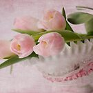 Tulips in a glass basket by Sue Purveur