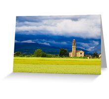 Evening storm over the medieval village Greeting Card