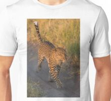 Leopard running along sandy track in grass Unisex T-Shirt