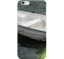 Small Boat Next to a Concrete Pier iPhone Case/Skin
