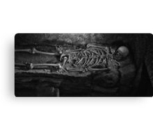 Skeleton In A Tomb Canvas Print
