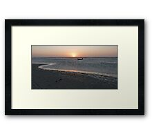 A lonely boat at sunset Framed Print