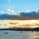 quiet bay with island near kenmare at sunset by morrbyte
