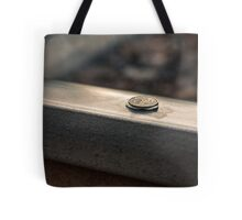 Coin on a chewing gum sticked to the railroad Tote Bag
