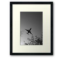 Low flying passenger jet Framed Print