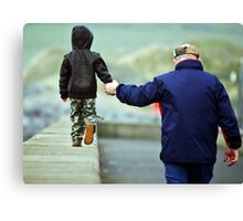 father and son walking by the beach. Canvas Print