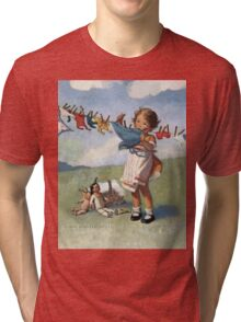 Jessie Willcox Smith - Hanging Doll Clothes On A Windy Day. Child portrait: cute baby, kid, children, pretty angel, child, kids, lovely family, boys and girls, boy and girl, mom mum mammy mam, Tri-blend T-Shirt