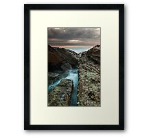 Norah heads sunrise with storm clouds Framed Print