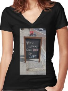 WHEN NOTHING GOES RIGHT, GO LEFT Women's Fitted V-Neck T-Shirt