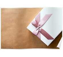White Gift Box With Pink Bow on Brown Paper Poster