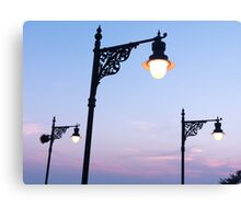 Street lamps over sunset sky background art photo print Canvas Print