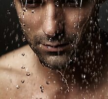 Thoughtful man face under pouring water art photo print by ArtNudePhotos