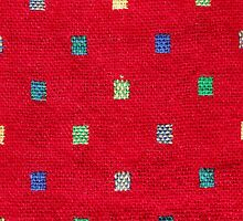red fabric background with colorful pattern  by newbietraveller