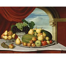 John Vanderlyn - Still Life Fruit In A Classical Setting 1858. Still life with fruits and vegetables: fruit, vegetable, grapes, tasty, gastronomy food, flowers, dish, cooking, kitchen, vase Photographic Print