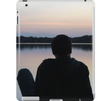 Man on the pier watching the sunset iPad Case/Skin