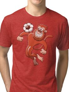 Monkey Trapping a Soccer Ball with its Chest Tri-blend T-Shirt