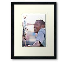 Dili on a stick Framed Print