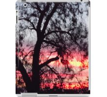Sun setting behind desolate trees iPad Case/Skin