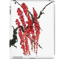 A branch of a blossoming cherry. Red flowers of sakura iPad Case/Skin