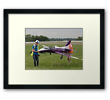 Model aircraft being carried after a display at the Festival of Flight in Biggin Hill Framed Print