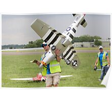 Model aircraft being carried after a display at the Festival of Flight in Biggin Hill Poster