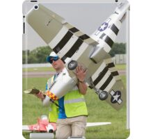 Model aircraft being carried after a display at the Festival of Flight in Biggin Hill iPad Case/Skin