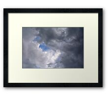 Fluffy stormy clouds. Framed Print