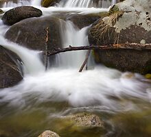 River Flowing over Rocks Art Print by Alan Mitchell