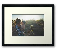 Woman holds her child Framed Print