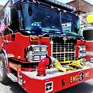 Front of Fire Truck With Hose by Susan Savad