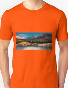 Early light on the mountains and the water Unisex T-Shirt