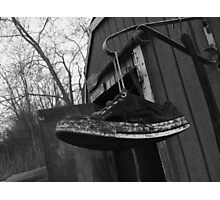 Old Sneaker Hanging By Its Laces Photographic Print