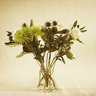 White roses, thistles and palm by Sarah Cowan