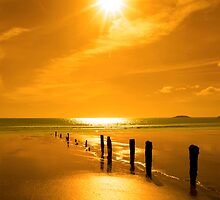 golden sunset over the beach breakers by morrbyte