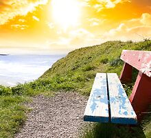 view of beach and Atlantic Ocean in Ballybunion with bench by morrbyte
