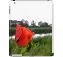 Poppy over river in norfolk iPad Case/Skin