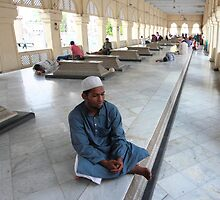 Man at Mecca Masjid Mosque by Andrew  Makowiecki