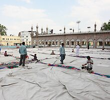 Packing Up at Mecca Masjid Mosque by Andrew  Makowiecki