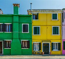 Colorful houses with bicycle by Roberto Pagani