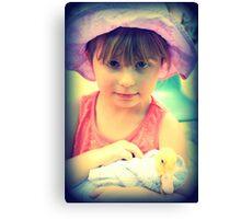 Little Girl Holding A Duck Canvas Print
