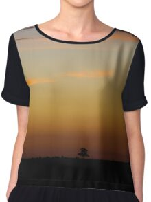 Orange sunset with single tree silhouette Chiffon Top