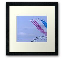 Red Arrows flying over London Eye Framed Print