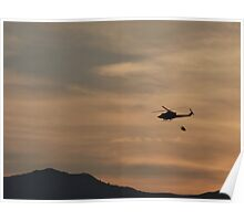Helicopter with water bag Silhouetted by the Sunset Poster