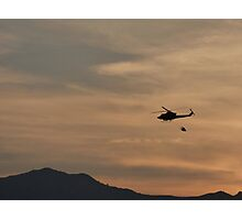 Helicopter with water bag Silhouetted by the Sunset Photographic Print