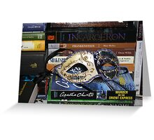 Mask Surrounded by Books Greeting Card