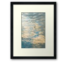 Blue sky reflections in a lake  Framed Print
