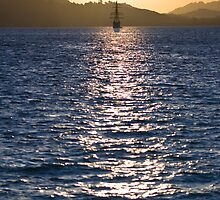 Sailboat bathed in dawn sunlight by 3523studio