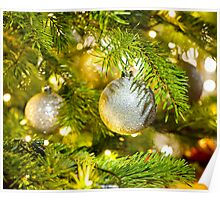 Bauble in a real Christmas tree in bright color  Poster