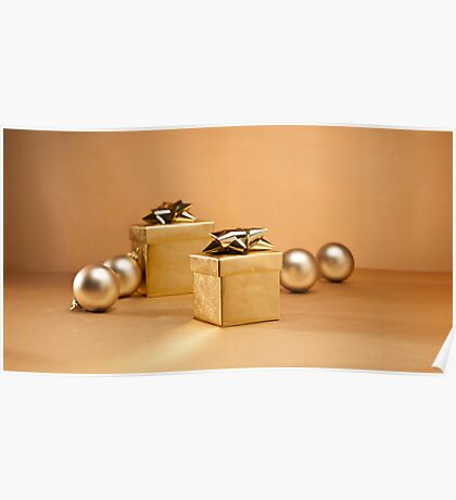 Gold bauble and present in Christmas setting Poster